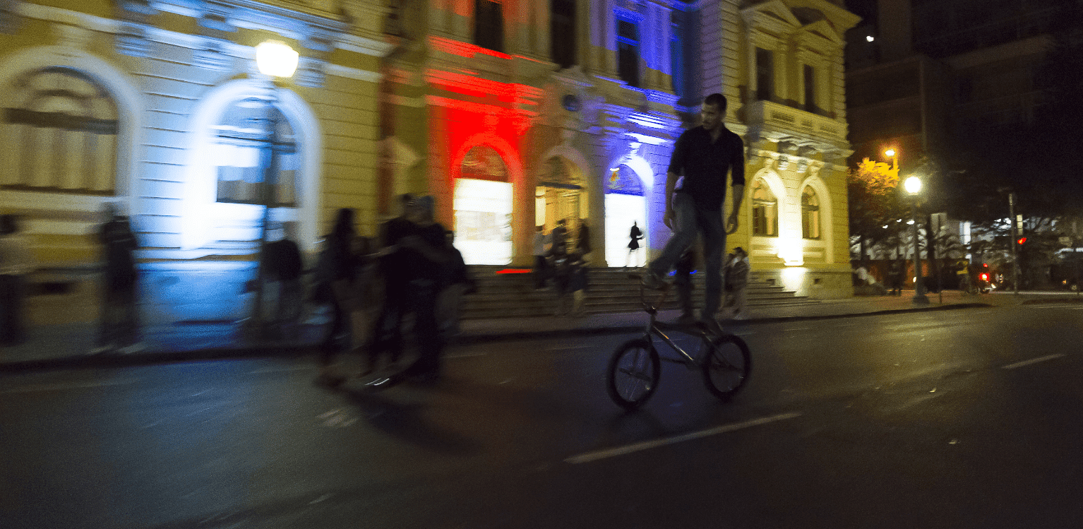 People on top of bicycles in presentation on the street